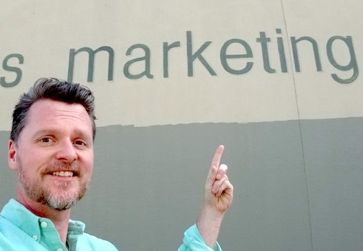 contact the austin editor for business seo, image shows marshall pointing at the word marketing